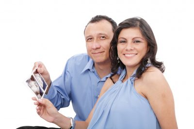 Couple holding an ultrasound photo